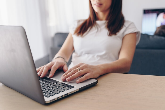 businesswoman working from home, typing on laptop