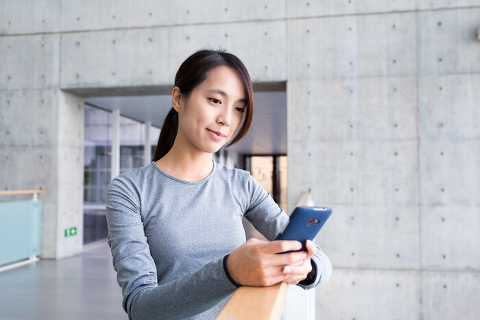 woman making payment with phone